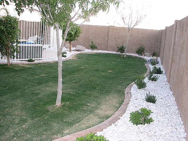 plants and gravel added to backyard
