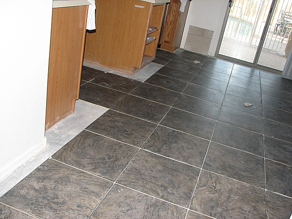 tile from stairway to kitchen
