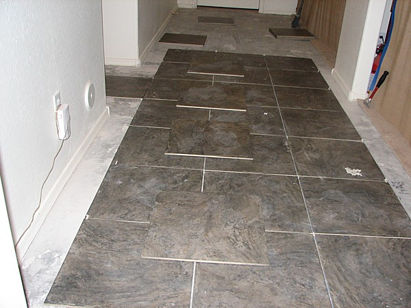 tile from kitchen to front door