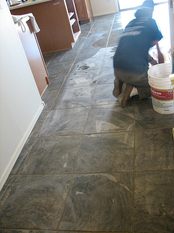 grout being wiped